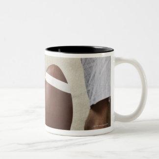 Man on Sofa with Football Two-Tone Coffee Mug