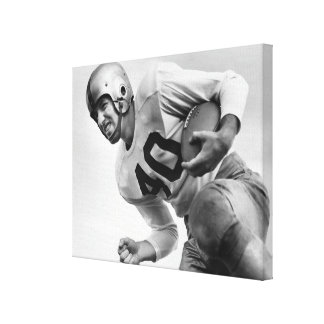 Man Playing Football Stretched Canvas Prints