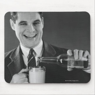 Man pouring beer from bottle to pitcher (B&W), Mouse Pad