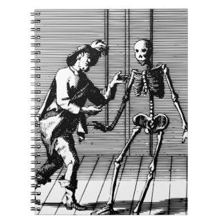 Man Proposing to a Skeleton Notebooks