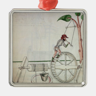 Man Putting into Motion a Wheel-Driven Well Metal Ornament