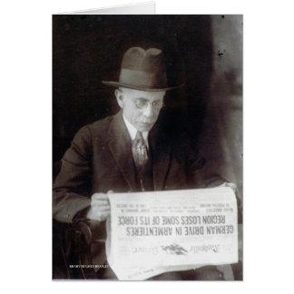 Man Reads War News Card