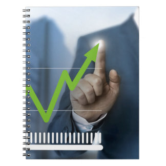 Man showing stock price touchscreen concept spiral notebook