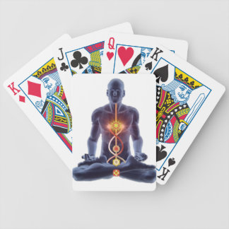 Man silhouette in enlightened yoga meditation pose bicycle playing cards