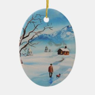 Man walking dog in snow winter mountain scene ceramic ornament