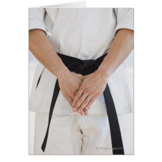 Man wearing karate black belt card