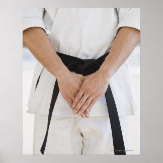 Man wearing karate black belt poster