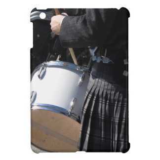 Man with kilt playing on drums case for the iPad mini