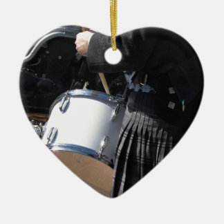 Man with kilt playing on drums ceramic heart ornament