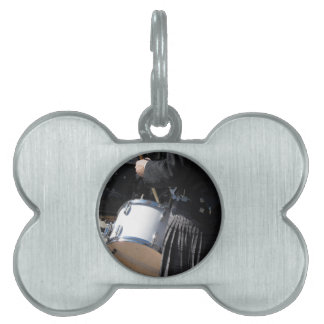 Man with kilt playing on drums pet name tag