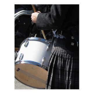Man with kilt playing on drums postcard