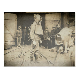 Man with oxygen helmet at a coal mine postcard