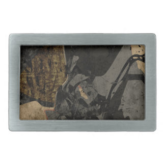Man with protective mask on dark metal plate belt buckles
