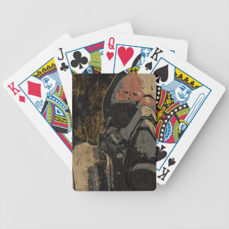 Man with protective mask on dark metal plate bicycle playing cards