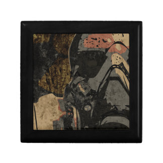 Man with protective mask on dark metal plate gift box