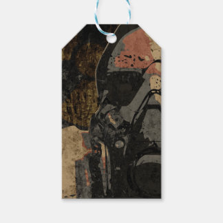 Man with protective mask on dark metal plate gift tags