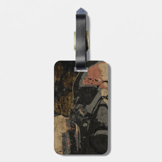 Man with protective mask on dark metal plate luggage tag