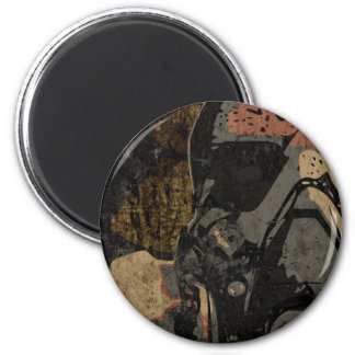 Man with protective mask on dark metal plate magnet