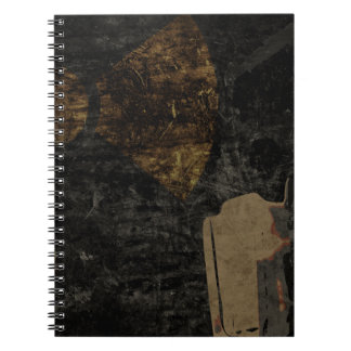 Man with protective mask on dark metal plate note book