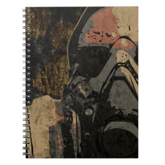 Man with protective mask on dark metal plate notebook