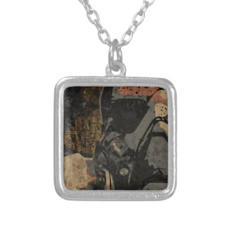 Man with protective mask on dark metal plate silver plated necklace