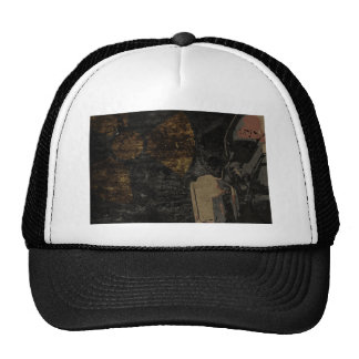 Man with protective mask on dark metal plate trucker hat