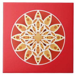 Mandala pattern in coral red, tan and white ceramic tile