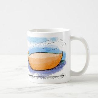 Mango shaped cat on a ledge mugs