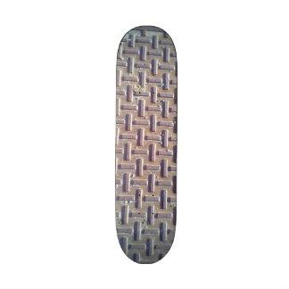 Manhole cover skateboard deck