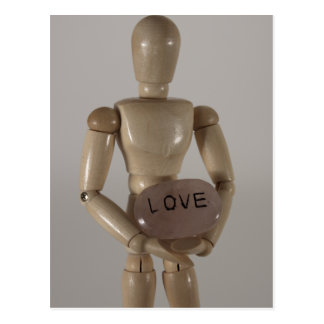"Mannequin holding ""Love"" Postcard"
