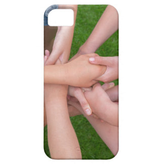 Many arms of children holding hands together iPhone 5 cover