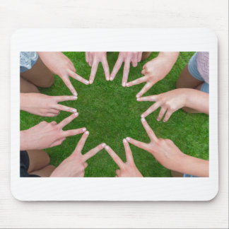 Many arms of children with hands making star mouse pad