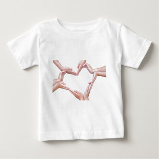 Many arms of girls construct heart on white baby T-Shirt