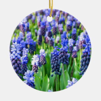 Many blue grape hyacinths round ceramic ornament