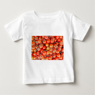 Many bunches of red vine tomatoes baby T-Shirt