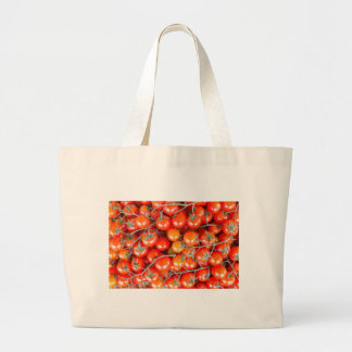 Many bunches of red vine tomatoes large tote bag