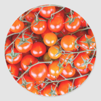 Many bunches of red vine tomatoes round sticker