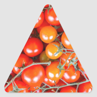 Many bunches of red vine tomatoes triangle sticker