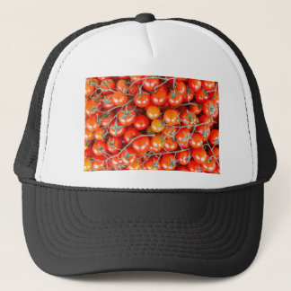 Many bunches of red vine tomatoes trucker hat