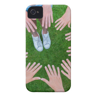 Many children hands joining in circle above grass iPhone 4 Case-Mate cases