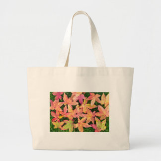 Many colorful autumn maple leaves on green grass large tote bag