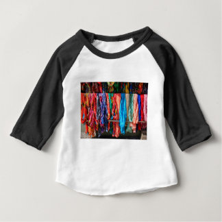 Many colorful scarves hanging at market baby T-Shirt