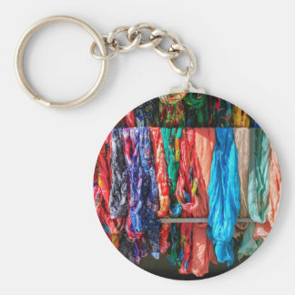 Many colorful scarves hanging at market basic round button keychain