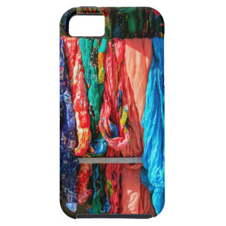Many colorful scarves hanging at market iPhone 5 cover