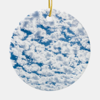 Many little white clouds and blue sky round ceramic ornament