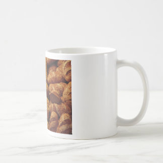 Many mixed breads and rolls background coffee mug