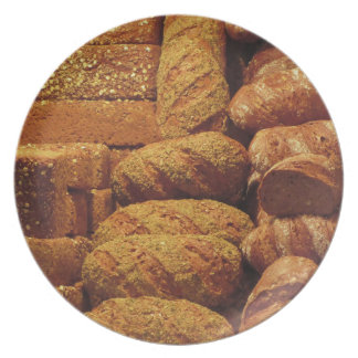 Many mixed breads and rolls background dinner plates