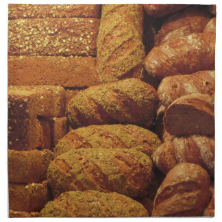Many mixed breads and rolls background napkins