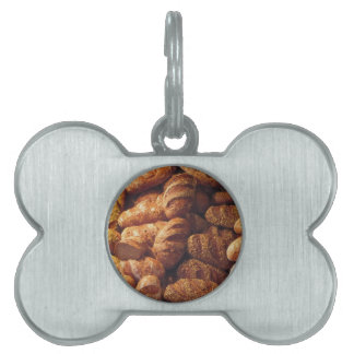 Many mixed breads and rolls background pet ID tag