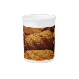 Many mixed breads and rolls background pitcher